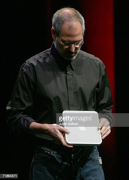 Apple CEO Steve Jobs holds a prototype of a device tenatively called iTV as he delivers a keynote address during an Apple media event September 12,...