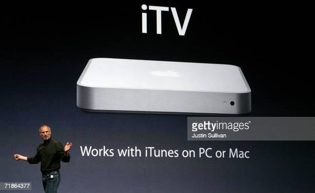 Apple CEO Steve Jobs holds announces a device tenatively called iTV as he delivers a keynote address during an Apple media event September 12, 2006...