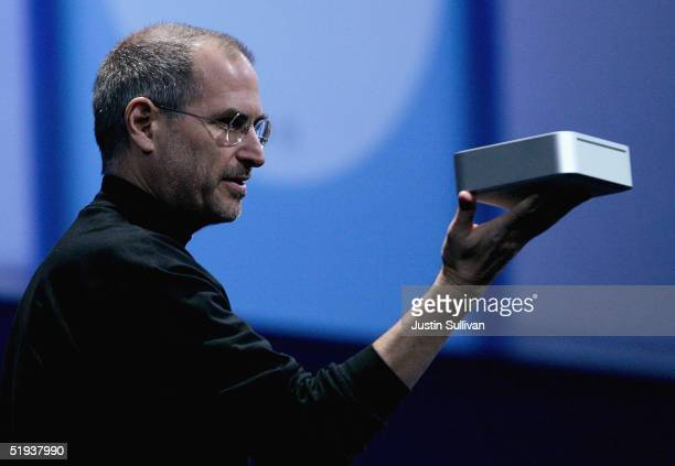 Apple CEO Steve Jobs holds the new Mac Mini personal computer during his keynote address at the 2005 Macworld Expo January 11, 2005 in San Francisco,...