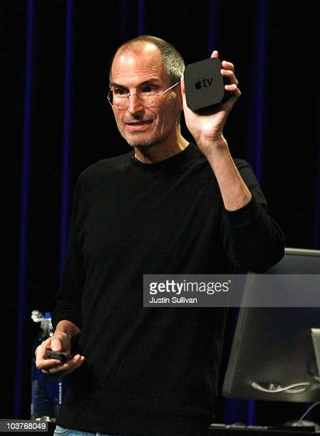 Apple CEO Steve Jobs holds the new smaller Apple TV device as speaks during an Apple Special Event at the Yerba Buena Center for the Arts September 1...