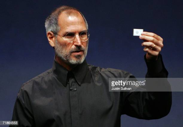 Apple CEO Steve Jobs holds up a new iPod Shuffle as he delivers a keynote address during an Apple media event September 12, 2006 in San Francisco....