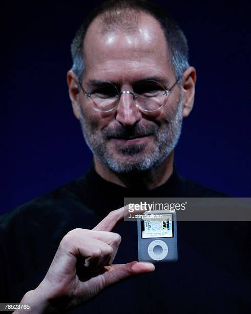 Apple CEO Steve Jobs holds up a new version of the iPod Nano during an Apple Special event September 5 2007 in San Francisco California Jobs...