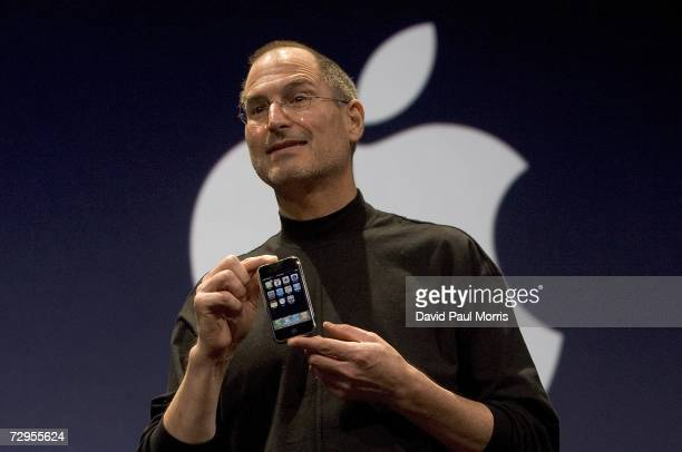 Apple CEO Steve Jobs holds up the new iPhone that was introduced at Macworld on January 9, 2007 in San Francisco, California. The new iPhone will...