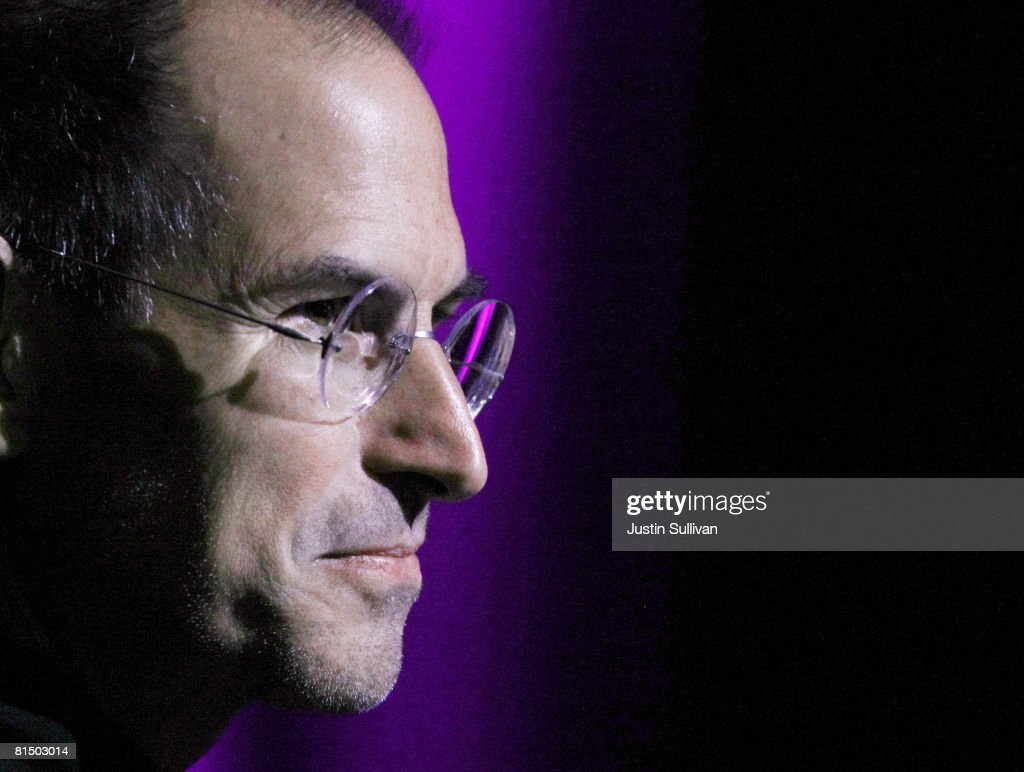 Apple CEO Steve Jobs looks on before announcing the new iPhone 3G as he delivers the keynote address at the Apple Worldwide Web Developers Conference June 9, 2008 in San Francisco, California. Jobs kicked off the 2008 WWDC conference with a keynote where he announced an upgraded version of the popular iPhone called the iPhone 3G.