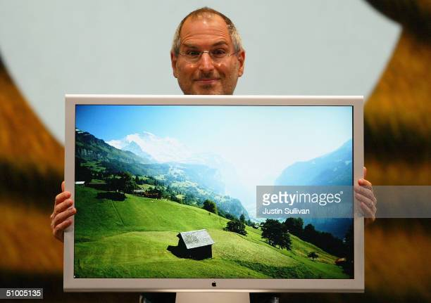Apple CEO Steve Jobs poses with the new 30inch flat panel display as he delivers the keynote address at the 2004 Worldwide Developers Conference June...