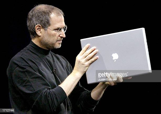 Apple CEO Steve Jobs shows off the new 17inch Powerbook G4 while delivering the keynote address at Macworld January 7 2003 in San Francisco Along...