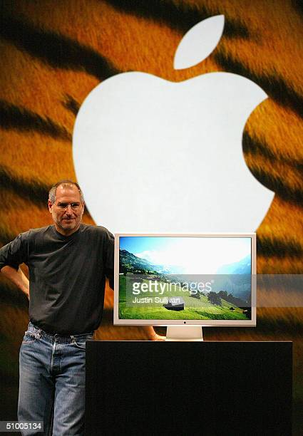 Apple CEO Steve Jobs stands next to a new 30inch flat panel display as he delivers the keynote address at the 2004 Worldwide Developers Conference...