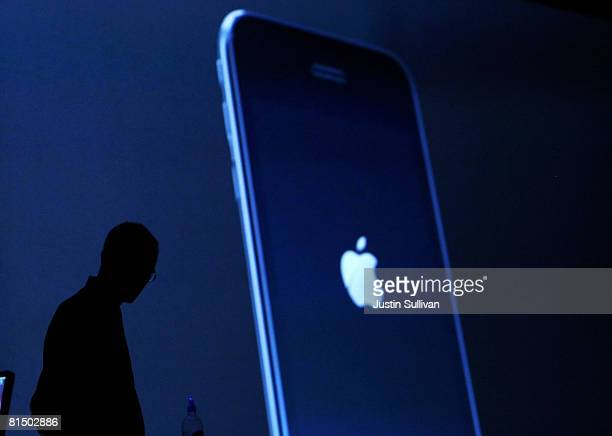 Apple CEO Steve Jobs watches a video of the new iPhone 3G as he delivers the keynote address at the Apple Worldwide Web Developers Conference June 9...