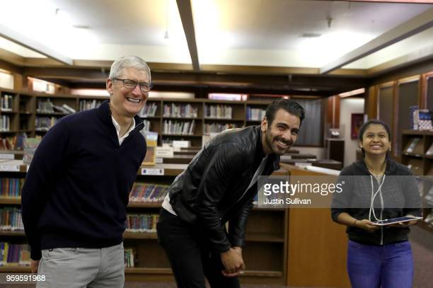 Apple CEO Tim Cook and actor model and activist for the deaf community Nyle DiMarco laugh as they watch a demonstration with a drone at the...