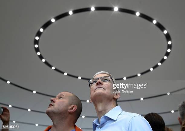 Apple CEO Tim Cook and Apple chief design officer Jonathan Ive tour the display area during an Apple special event at the Steve Jobs Theatre on the...