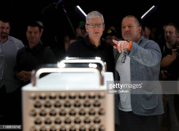 Apple CEO Tim Cook and Apple chief design officer Jony Ive look at the new Mac Pro during the 2019 Apple Worldwide Developer Conference at the San...
