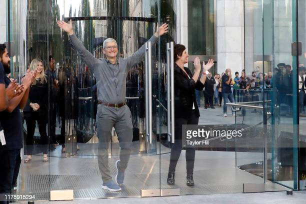 Apple CEO Tim Cook and Apple SVP RetailPeople Deirdre O'Brien open the doors at the grand reopening of Apple's flagship Apple Fifth Avenue retail...