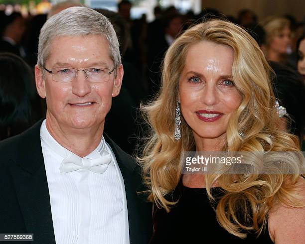 Apple CEO Tim Cook and Laurene PowellJobs widow of Steve Jobs attend 'Manus x Machina Fashion in an Age of Technology' the 2016 Costume Institute...