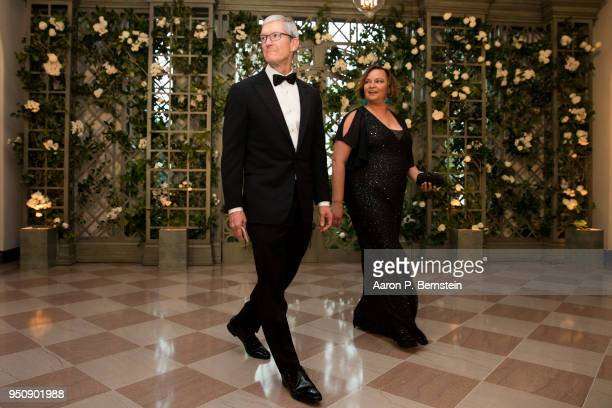 Apple CEO Tim Cook and Lisa Jackson arrive at the White House for a state dinner April 24 2018 in Washington DC President Donald Trump is hosting...