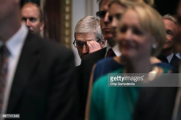 Apple CEO Tim Cook and other technology executives and leaders listen to Senior White House adviser Jared Kushner during the inaugural meeting of the...