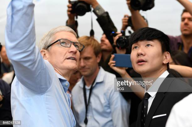 Apple CEO Tim Cook and singer JJ Lin look on during the Apple launch event on September 12 2017 in CupertinoCalifornia Apple Inc unveiled its new...