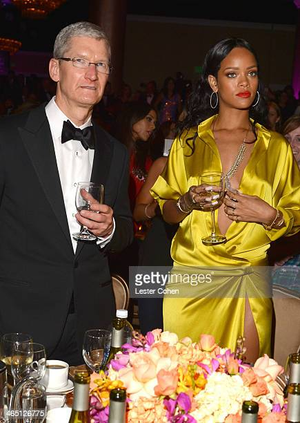 Apple CEO Tim Cook and singer Rihanna attend the 56th annual GRAMMY Awards PreGRAMMY Gala and Salute to Industry Icons honoring Lucian Grainge at The...