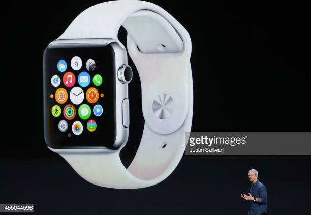 Apple CEO Tim Cook announces the Apple Watch during an Apple special event at the Flint Center for the Performing Arts on September 9 2014 in...