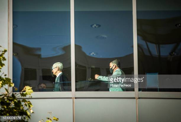 Apple CEO Tim Cook , followed by Apple security personnel Jimmy Taranto, makes his way to court after arriving at the United States District Court on...