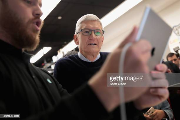Apple CEO Tim Cook gets a demonstration of an app during an event held to introduce the new 97inch Apple iPad at Lane Tech College Prep High School...