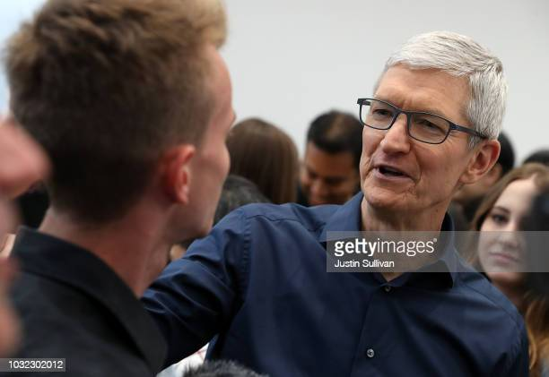 Apple CEO Tim Cook greets a visitor during an Apple special event at the Steve Jobs Theatre on September 12 2018 in Cupertino California Apple...