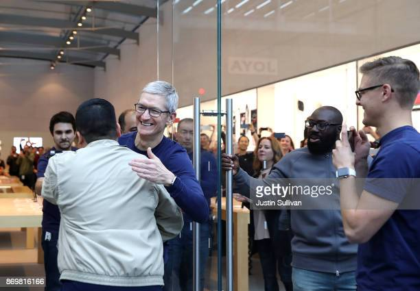 Apple CEO Tim Cook greets customers as they prepare to purchase a new iPhone X at an Apple Store on November 3 2017 in Palo Alto California The...