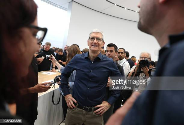 Apple CEO Tim Cook greets visitors during an Apple special event at the Steve Jobs Theatre on September 12 2018 in Cupertino California Apple...