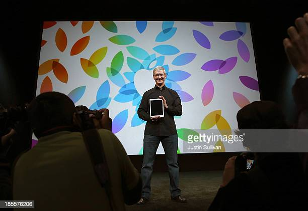 Apple CEO Tim Cook holds the new iPad Air during an Apple announcement at the Yerba Buena Center for the Arts on October 22, 2013 in San Francisco,...