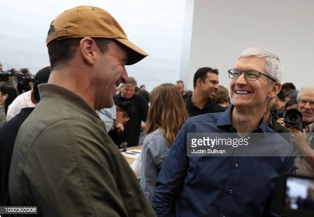 Apple CEO Tim Cook laughs with actor Jon Hamm during an Apple special event at the Steve Jobs Theatre on September 12 2018 in Cupertino California...