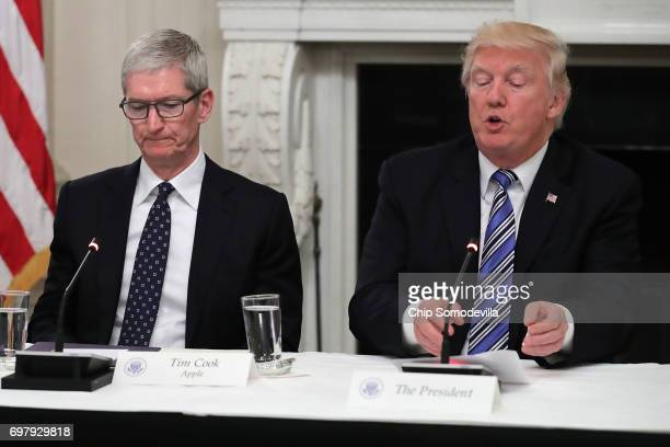 Apple CEO Tim Cook listens to US President Donald Trump deliver opening remarks during a meeting of the American Technology Council in the State...