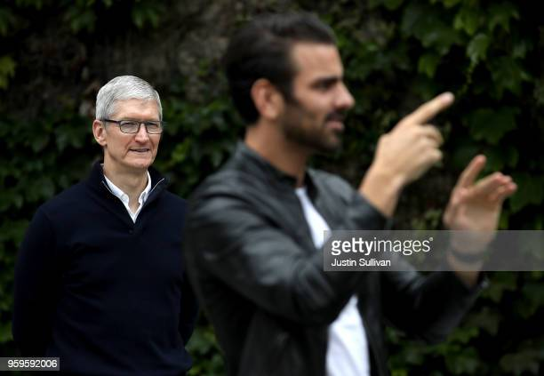 Apple CEO Tim Cook looks on as actor model and activist for the deaf community Nyle DiMarco speaks to students at the California School for the Deaf...