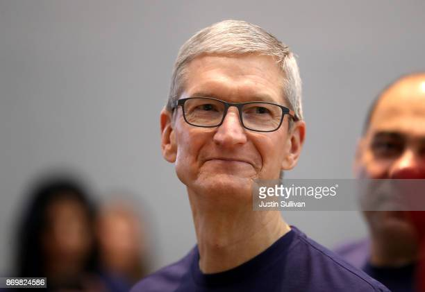 Apple CEO Tim Cook looks on as the new iPhone X goes on sale at an Apple Store on November 3 2017 in Palo Alto California The highly anticipated...