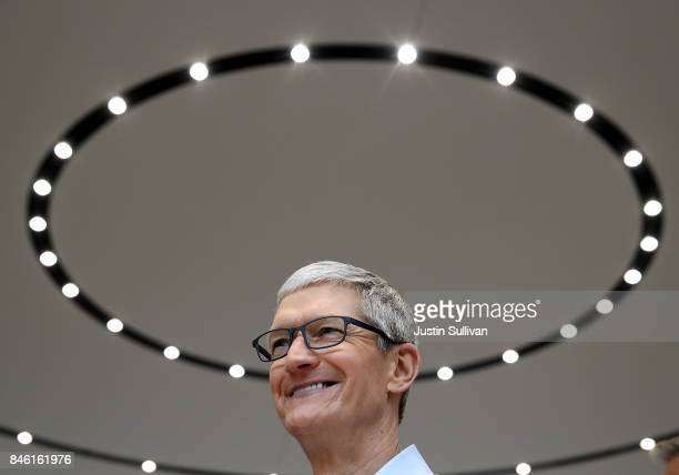 Apple CEO Tim Cook looks on during an Apple special event at the Steve Jobs Theatre on the Apple Park campus on September 12 2017 in Cupertino...