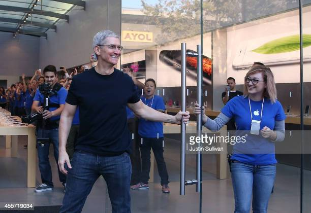 Apple CEO Tim Cook opens the door to an Apple Store to begin sales of the new iPhone 6 on September 19 2014 in Palo Alto California Hundreds of...