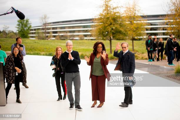 Apple CEO Tim Cook , Oprah Winfrey and director Steven Spielberg stand for a photo during an event launching Apple tv+ at Apple headquarters on March...