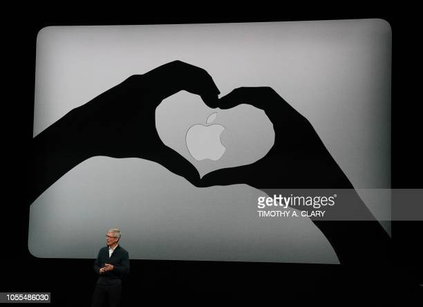 TOPSHOT Apple CEO Tim Cook presents new products including new Macbook laptops during a special event at the Brooklyn Academy of Music Howard Gilman...