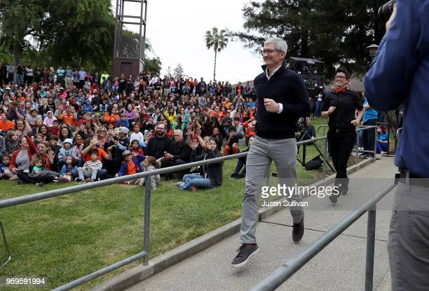 Apple CEO Tim Cook runs to the stage as he prepares to speak to students at the California School for the Deaf on May 17 2018 in Fremont California...
