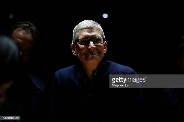 Apple CEO Tim Cook smiles during a product launch event on October 27 2016 in Cupertino California Apple Inc unveiled the latest iterations of its...