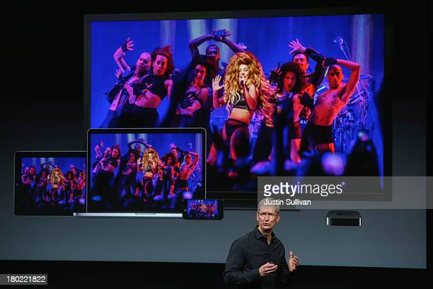 Apple CEO Tim Cook speaks about the iTunes music festival on stage during an Apple product announcement at the Apple campus on September 10 2013 in...