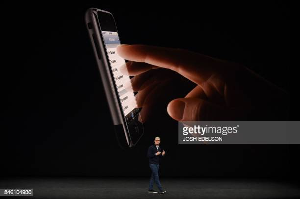 Apple CEO Tim Cook speaks about the new iPhone 8 during a media event at Apple's new headquarters in Cupertino California on September 12 2017 / AFP...