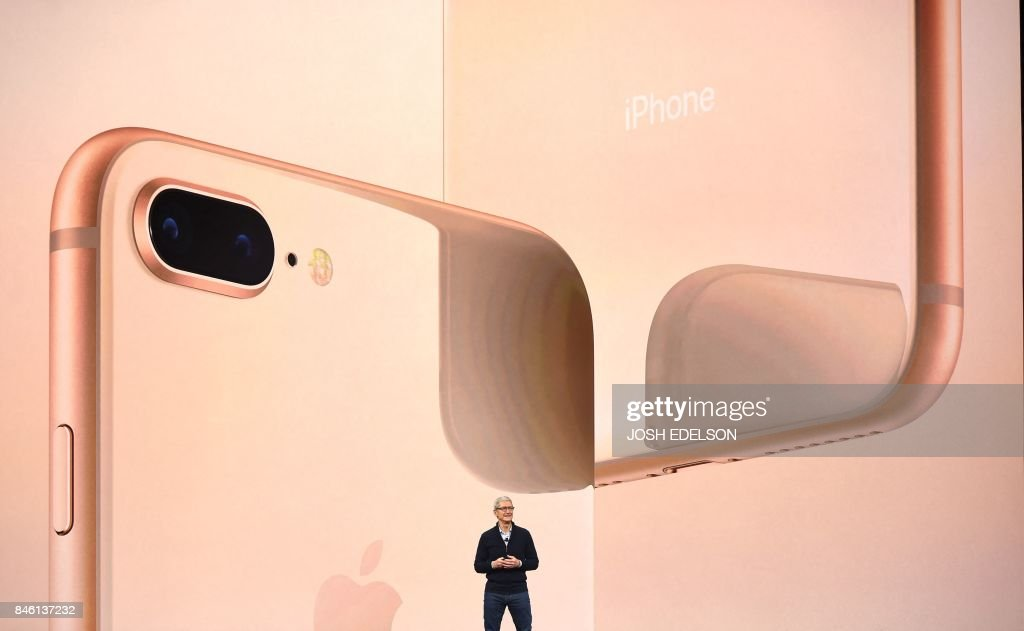TOPSHOT - Apple CEO Tim Cook speaks about the new iPhone lineup during a media event at Apple's new headquarters in Cupertino, California on September 12, 2017. / AFP PHOTO / Josh Edelson