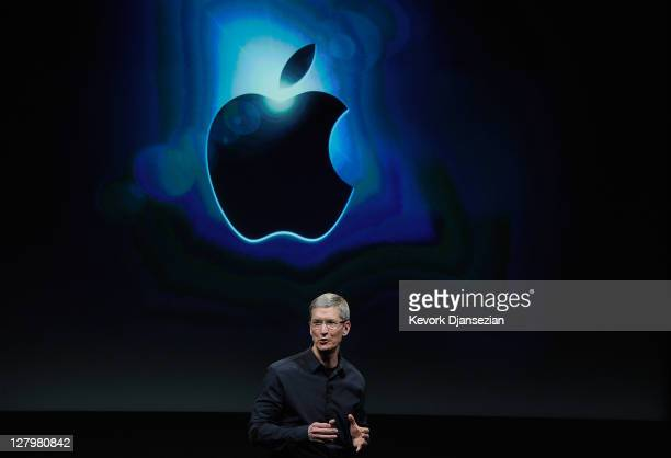 Apple CEO Tim Cook speaks at the event introducing the new iPhone 4s at the company's headquarters October 4 2011 in Cupertino California The...