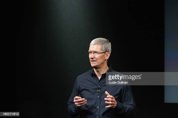 Apple CEO Tim Cook speaks on stage during an Apple product announcement at the Apple campus on September 10 2013 in Cupertino California The company...