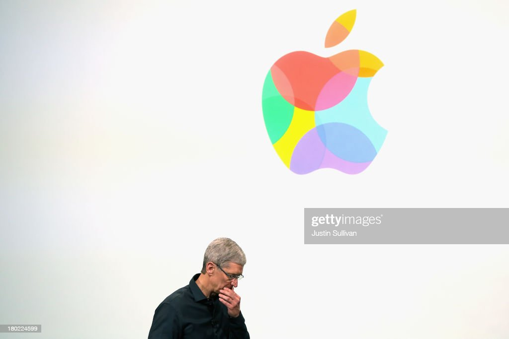 Apple CEO Tim Cook speaks on stage during an Apple product announcement at the Apple campus on September 10, 2013 in Cupertino, California. The company launched two new iPhone models that will run iOS 7. The 5C is made from a hard-coated polycarbonate and comes in five colors. The 5S comes in three colors, features a fingerprint sensor, has an upgraded camera, and contains an A7 chip.