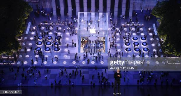 TOPSHOT Apple CEO Tim Cook speaks onstage during a product launch event at Apple's headquarters in Cupertino California on September 10 2019 Apple...