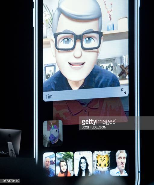 Apple CEO Tim Cook speaks using his Memoji during a group FaceTime call on stage during Apple's Worldwide Developer Conference at the San Jose...