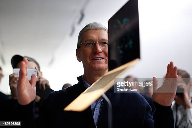 Apple CEO Tim Cook stands in front of an MacBook on display after an Apple special event at the Yerba Buena Center for the Arts on March 9 2015 in...