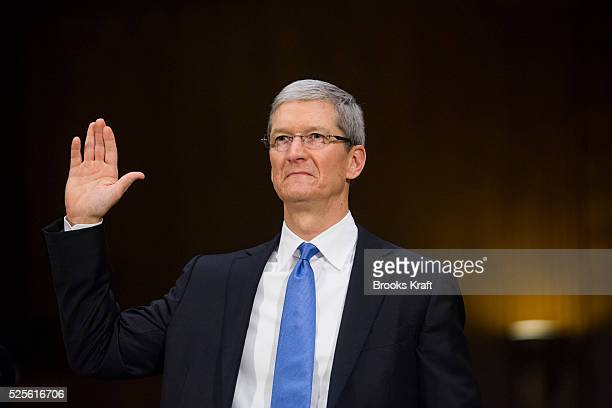 Apple CEO Tim Cook takes the oath before testifying at a Senate homeland security and governmental affairs investigations subcommittee hearing on...