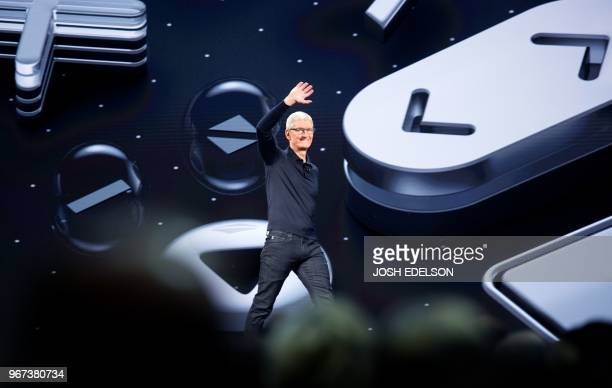 Apple CEO Tim Cook takes the stage during Apple's Worldwide Developer Conference at the San Jose Convention Centerin San Jose California on June 4...