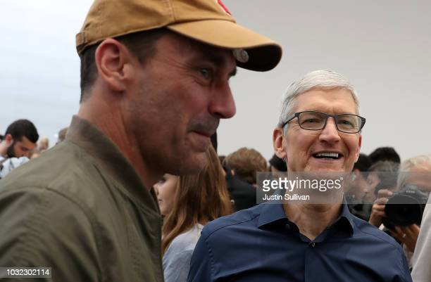Apple CEO Tim Cook talks with actor Jon Hamm during an Apple special event at the Steve Jobs Theatre on September 12 2018 in Cupertino California...